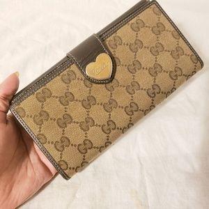 406da22ad Gucci. Gucci monogram heart continental wallet